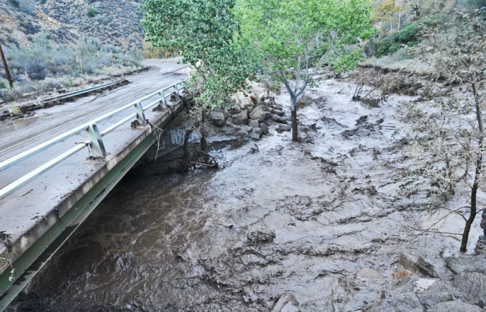 Dark, muddy water rushes down the canyon under Lake Hughes Road north of Castaic Lake on Oct. 15, 2015 after a heavy downpour caused a flash flood that washed out many sections of the canyon roads in the Angeles National Forest, and a section of northbound Interstate 5 near Fort Tejon. KATHARINE LOTZE/Signal.