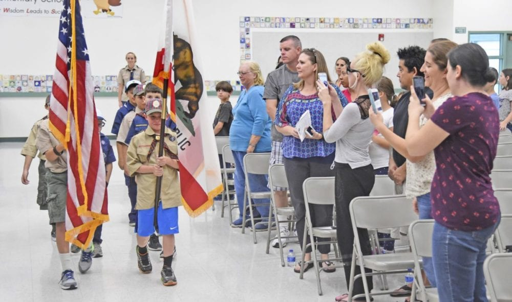 Cub Scouts from Troops 608 of Newhall carry the colors to open the official ceremony for the opening of two new permanent modular buildings at Old Orchard Elementary School in Newhall on Monday. Dan Watson/The Signal