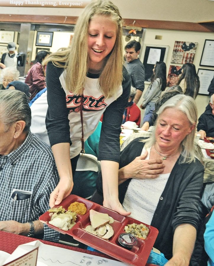 Signal File Photo: Hart High School student Aspen Sorenson serves seniors at the Santa Clarita Valley Senior Center during last year's Thanksgiving feast, hosted by the Castaic Lions Club, the William S. Hart Union High School District and the SCV Senior Center in Newhall on Thursday. Dan Watson/the Signal