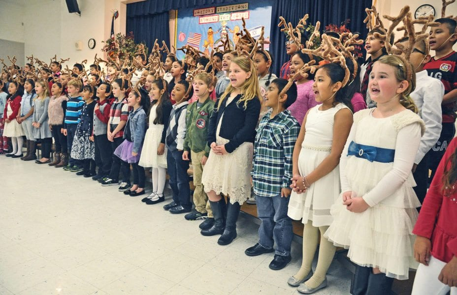 Second grade students share holiday songs, traditions from around the world