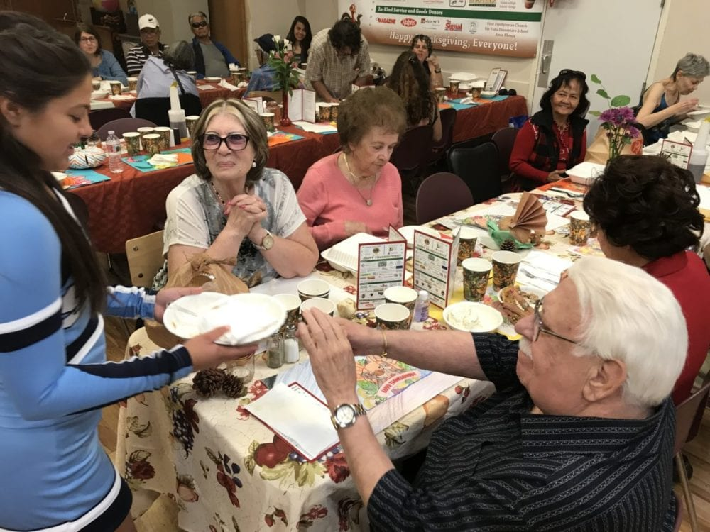 Marissa Roberts, 14, left, clears the plates for (clockwise from left) Rita Refaat, Margaret Tanczos, Jennifer Chu, Margaret Tanczos and Jim Brockman.