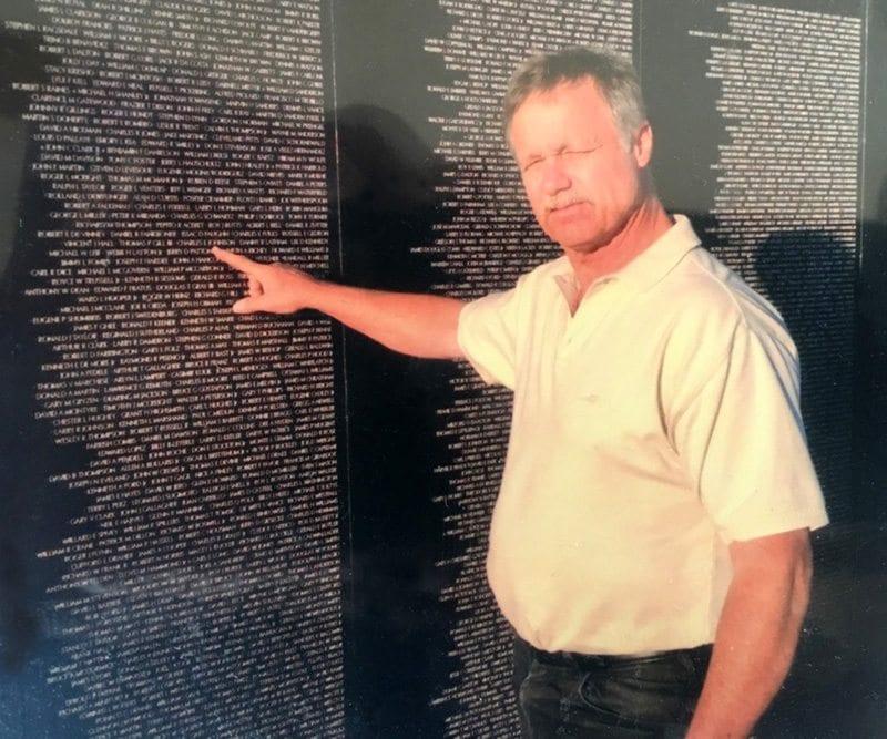 Larry E. Hubbard Pointing to a buddies name. Santa Clarita's Traveling Wall.