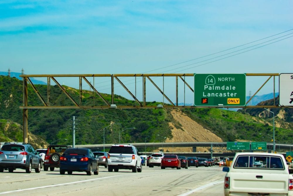 Overhead highway sign crashes onto freeway, diverts traffic