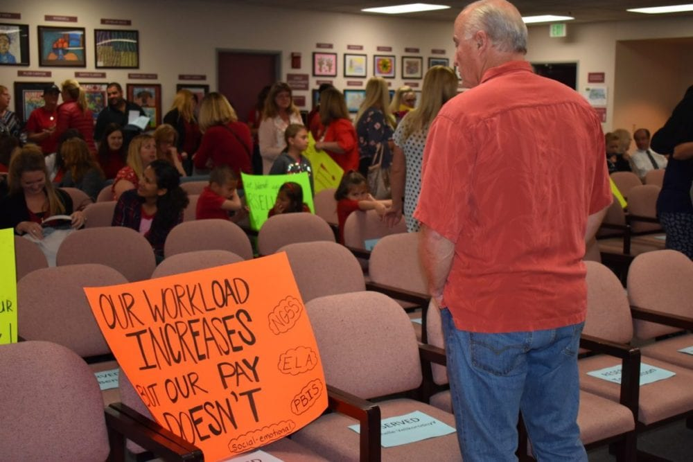 Teachers protest before recognition ceremony