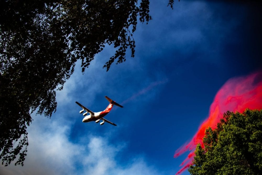 A Neptune Aviation BAe-146 makes a Phoschek drop on the South Fire in Newhall. Cory Rubin/The Signal