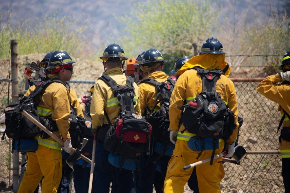 An LA City Fire crew prepares to head down Clampitt Road and fight the Sierra Fire on Tuesday, June 19, 2018.  Cory Rubin/The Signal