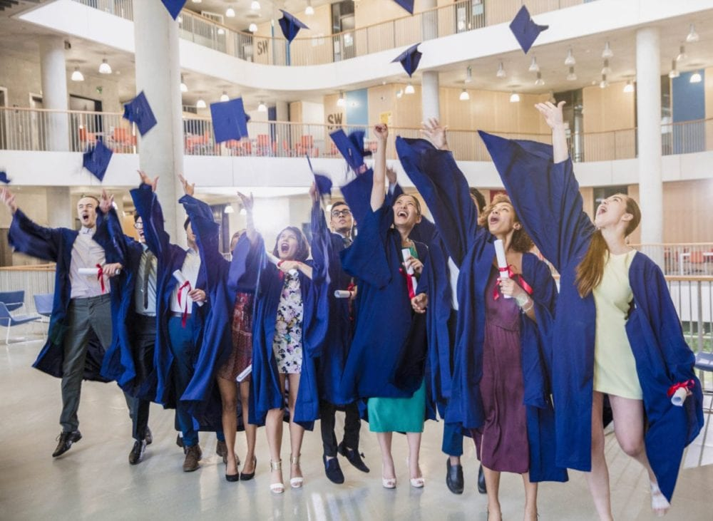 MC-graduates_group_indoor