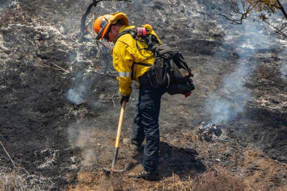A Los Angeles County Firefighter works to dig a containment line around the Tesoro Fire in North Valencia.  The Fire started at 10:48 am and the caue is under investigation.  Cory Rubin/ The Signal