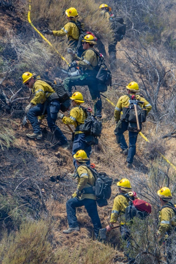Camp crews work to dig a contrainment lin around the Tesoro Fire in North Valencia.  The Fire started at 10:48 am and the caue is under investigation.  Cory Rubin/ The Signal