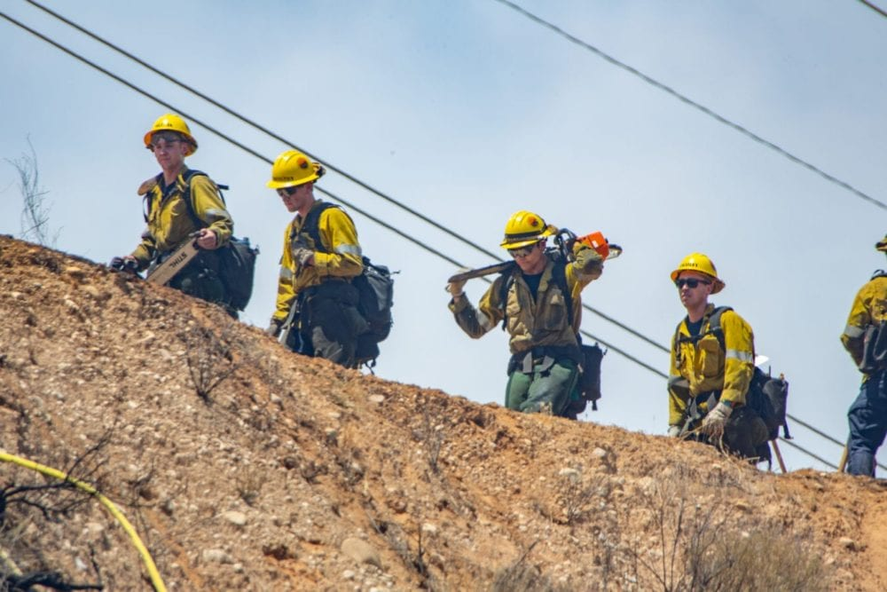 Camp Crews hike up the ridge to the Tesoro Fire in North Valencia.  The Fire started at 10:48 am and the caue is under investigation.  Cory Rubin/ The Signal