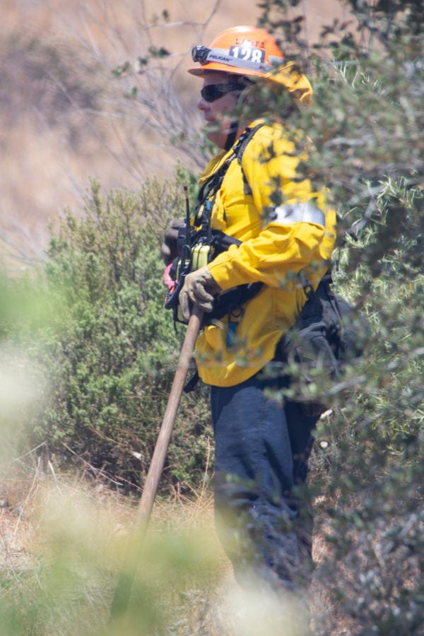 A fire caption from station 128 gives commands to the crews working in the hills at the Tesoro Fire in North Valencia.  The Fire started at 10:48 am and the caue is under investigation.  Cory Rubin/ The Signal