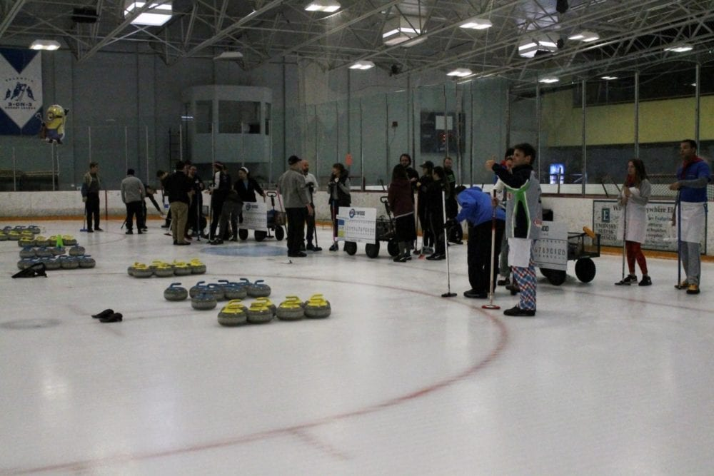 curling standing around