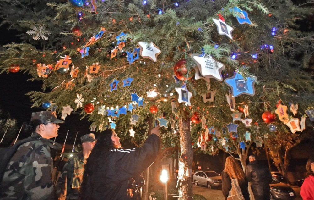 City, speakers remember loved ones in the military at annual tree and Menorah lighting ceremony