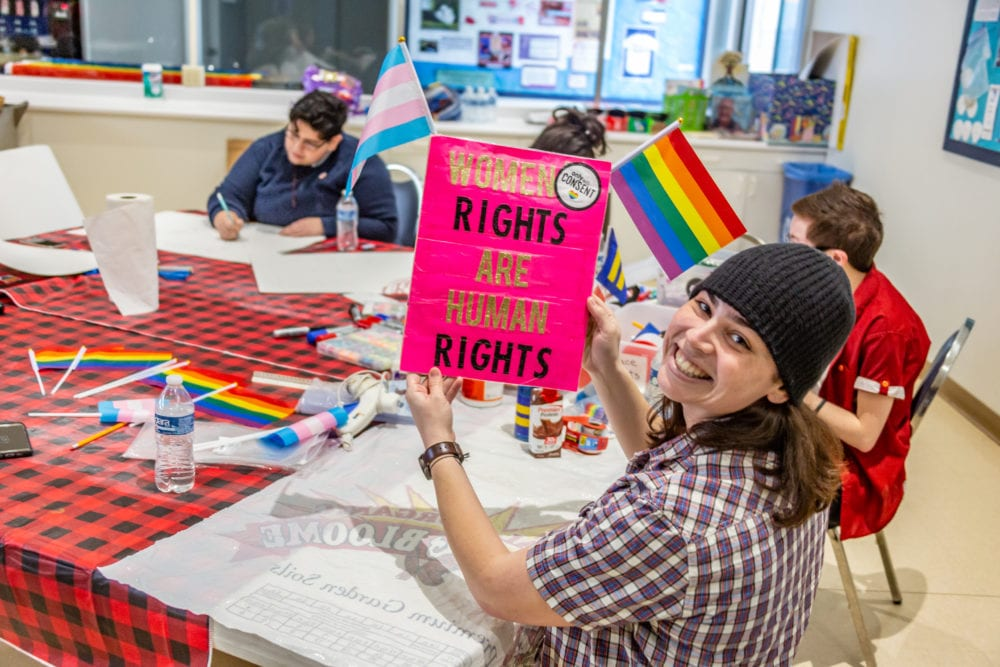 QueerSCV gets signs and posters ready ahead of Women's March Los Angeles