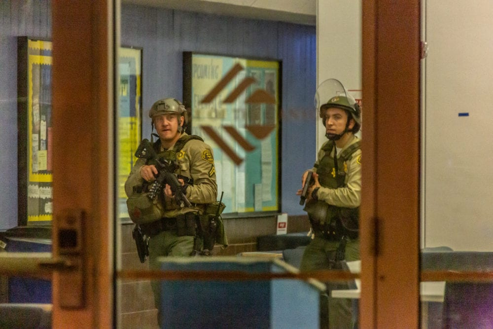 UPDATE: Woman with gun at COC turns out to be woman gathering sticks