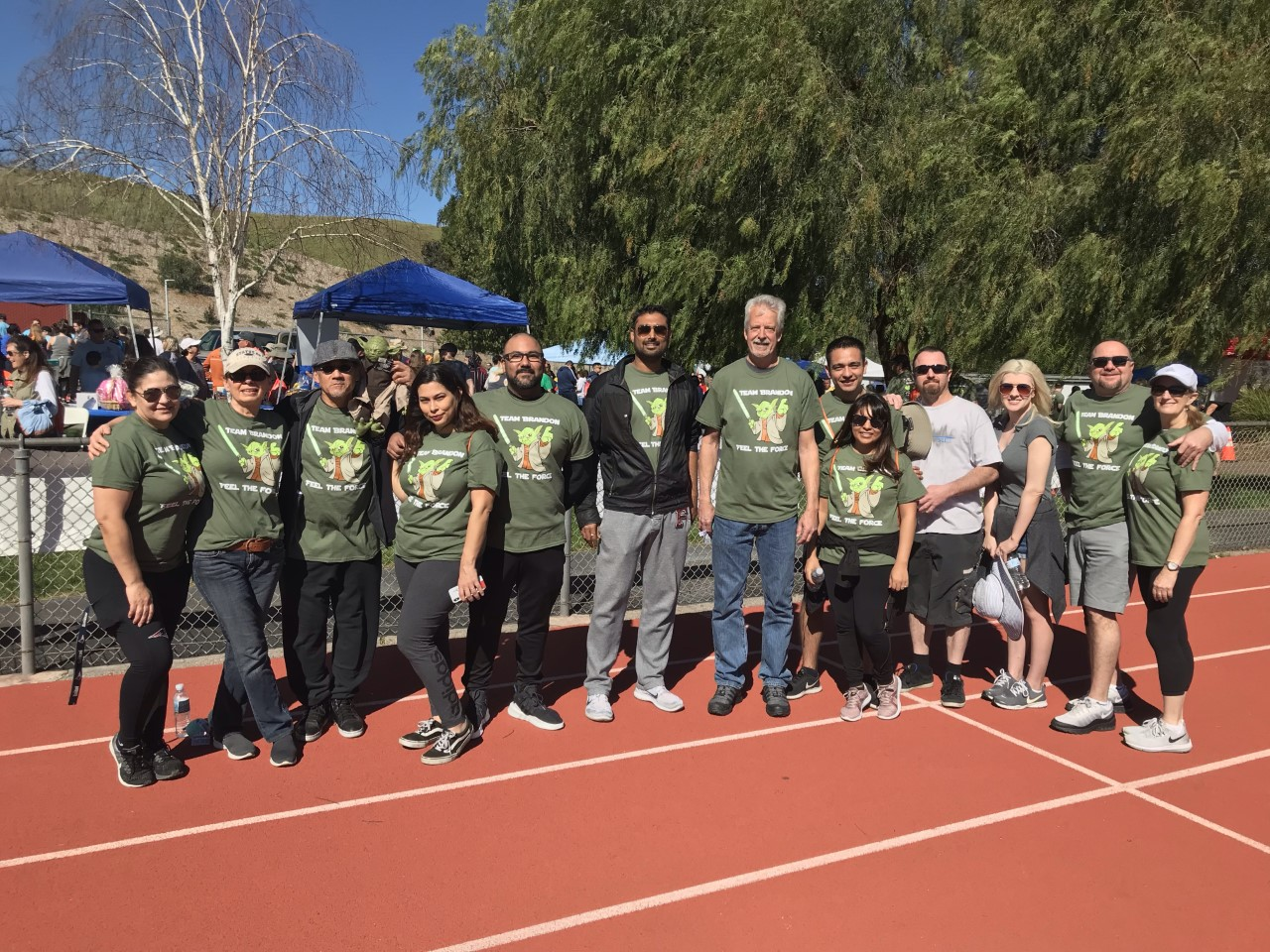 Families, businesses cross COC for annual walk for loved ones with cancer