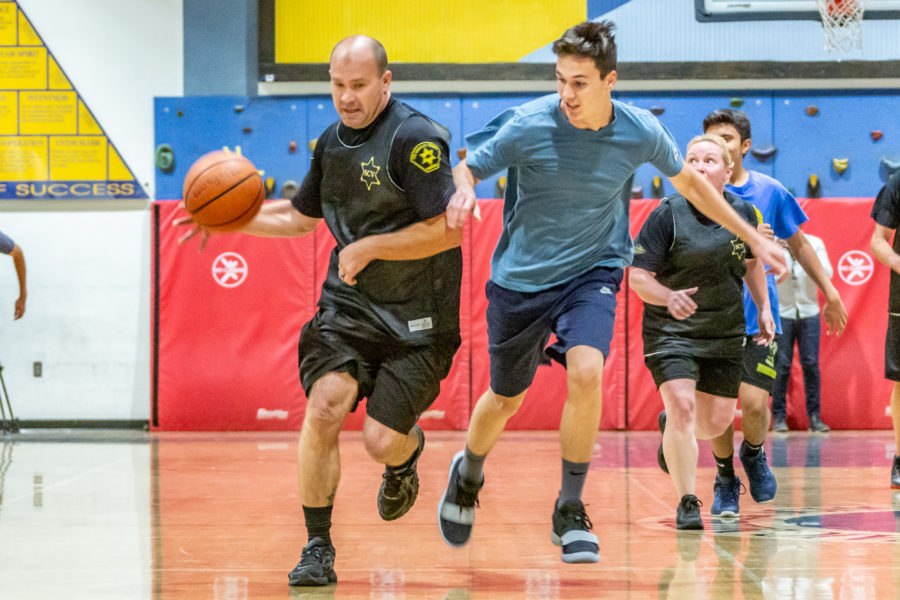 Students battle law enforcement on the basketball court