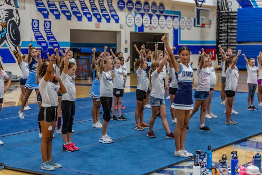 Saugus cheer team teaches community girls their sport