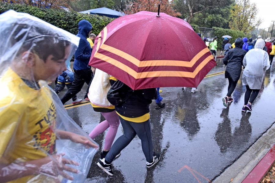 COC's 'Turkey Trot' brings out dozens during heavy downpour