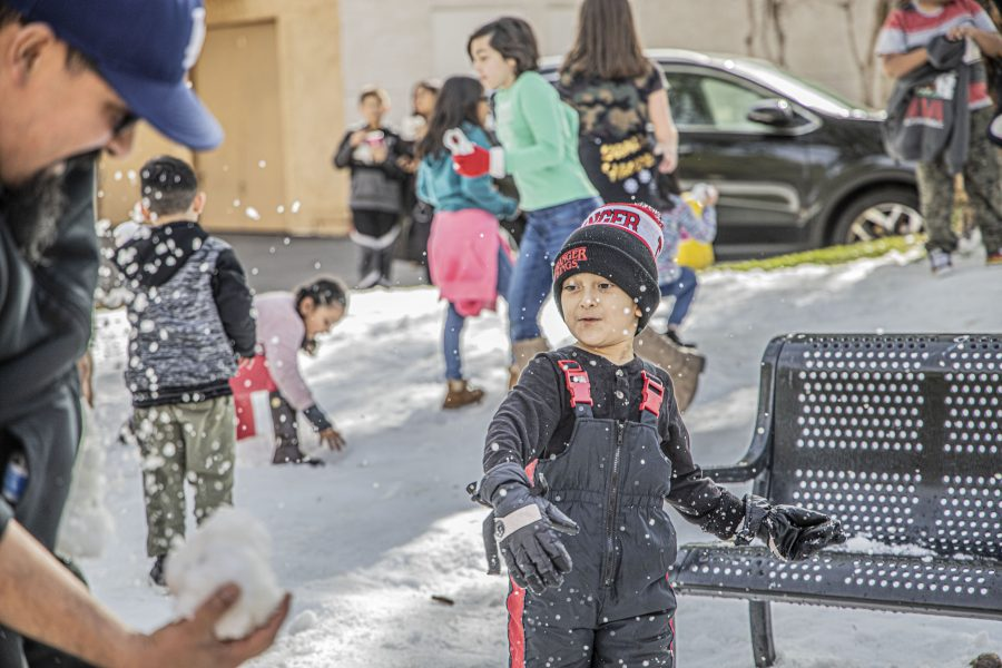 Families play in snow on Jakes Way