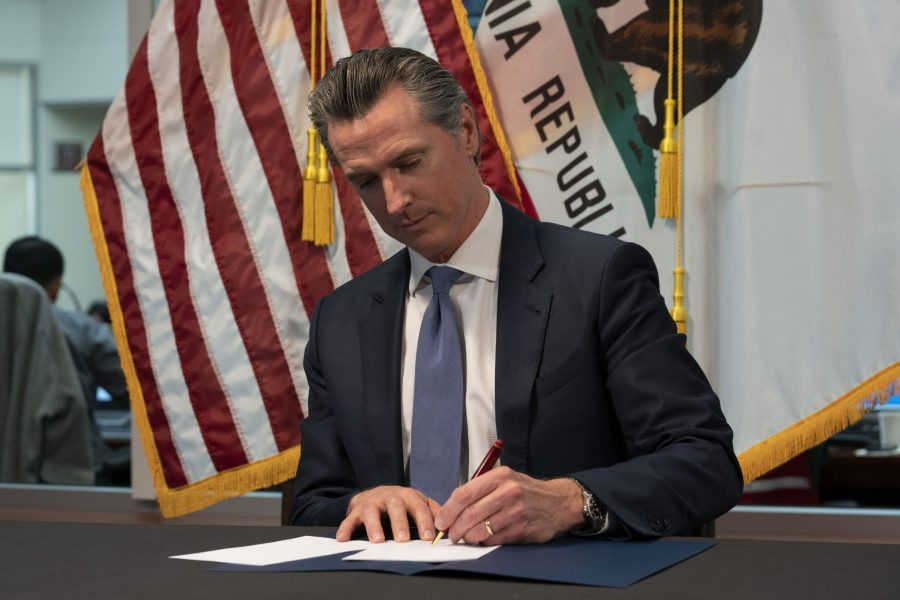 Newsom signs executive order for in-person voting in November