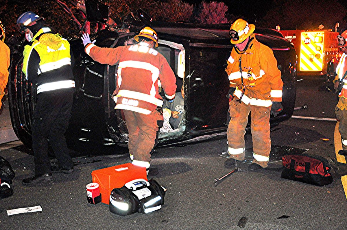 Firefighters extricate man through windshield after rollover crash