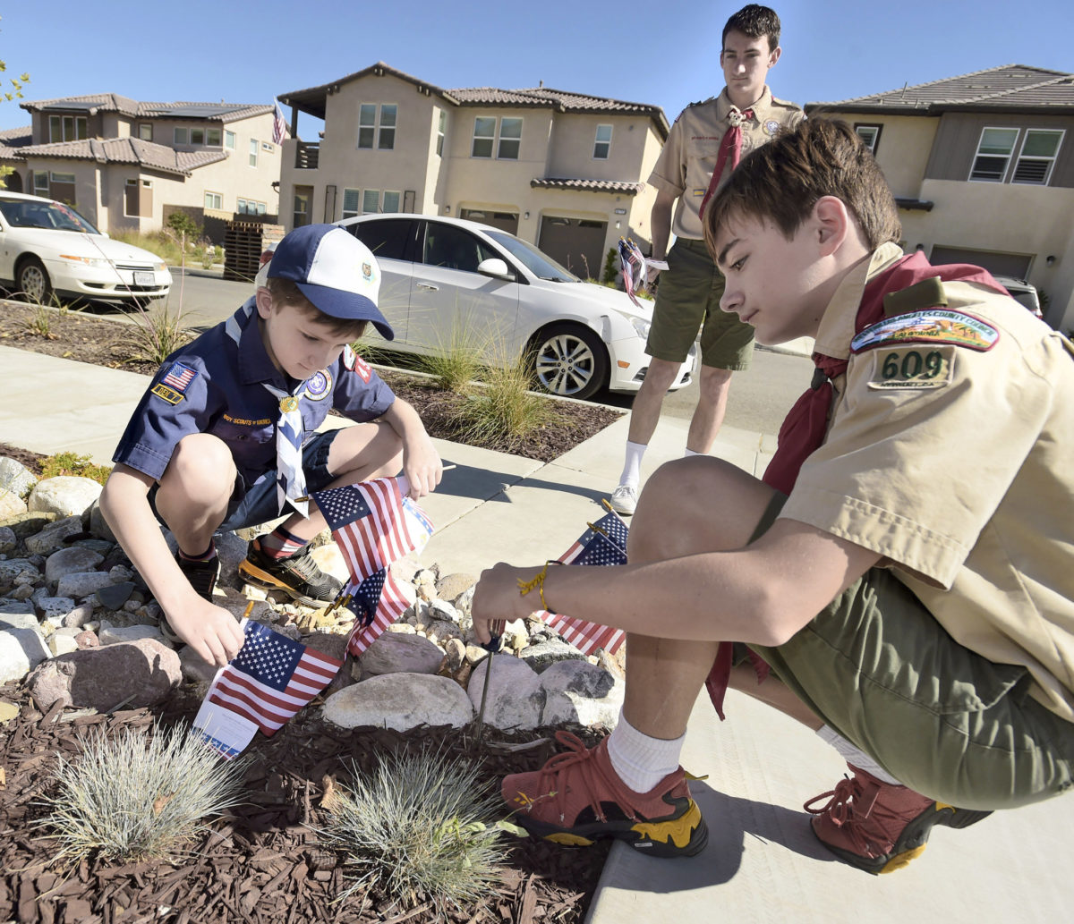 Cub Scout pack plants 400 American Flags in local neighborhoods