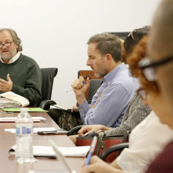 Assistant Director of Student Health and Wellness/Mental Health Program and chair of The Santa Clarita Valley Suicide Prevention, Postvention and Wellness Committee, Larry Schallert, talks during a discussion among committee members from different agencies at College of the Canyons in Valencia in early 2018. Nikolas Samuels/The Signal