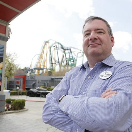 Neal Thurman, the president of Six Flags Magic Mountain and Hurricane Harbor, poses for a picture in front of Green Lantern: First Flight on Monday, Feb. 12, 2018. Nikolas Samuels/the Signal