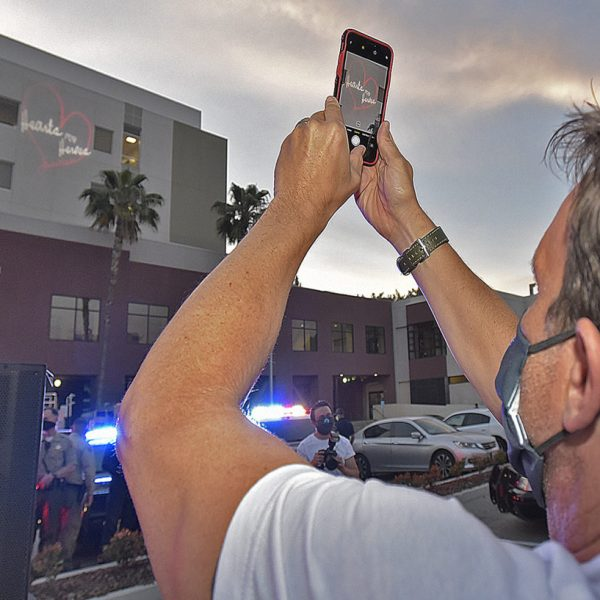 City of Santa Clarita Mayor Cameron Smyth takes a photo of the Hearts for Heroes logo is projected on the side of the new Tower of the Henry Mayo Newhall Hospital to thank essential workers for National Nurses Day in Valencia on Wednesday, May 06, 2020.  Dan Watson/The Signal