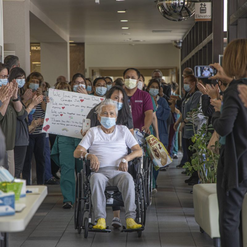 Henry Mayo Newhall Hospital nurse Charisse Hammer wheels her father, 79-year-old Jose Miranda Jr., out of the hospital as he is released after undergoing intensive treatment for COVID-19 for more than two months. June 01, 2020. Bobby Block / The Signal.