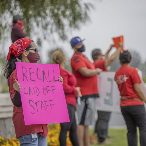 Registered nurses from Henry Mayo Hospital hold a rally at the intersection of Newhall Ranch Road and McBean Parkway Saturday morning to protest layoffs and what they describe as a lack of personal protective equipment at the hospital. June 20, 2020. Bobby Block / The Signal.