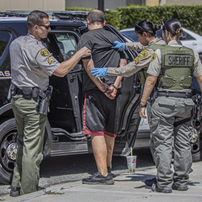 SCV Sheriff's Station deputies detain a man suspected of robbery near the 276000 block of Bouquet Canyon Road around 11:40 a.m. Tuesday. July 14, 2020. Bobby Block / The Signal.