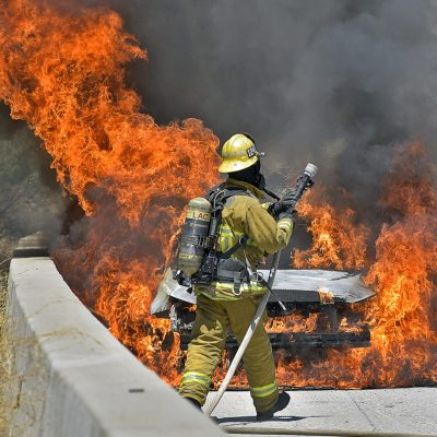 Firefighters arrive on the scene of a fully involved car fire on  southbound Interstate 5  near Weldon Canyon in Newhall on Friday, July 24, 2020.  Dan Watson/The Signal