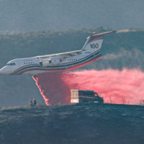 Fixed-wing aircraft aid firefighters as they battle the Castaic Fire near Castaic Lake Saturday afternoon. August 01, 2020. Bobby Block / The Signal.
