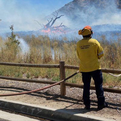 Los Angeles County Fire Department personnel battle a brush fire near the Elsmere Canyon hiking trail in Newhall on Monday, Aug. 3, 2020. Bobby Block/The Signal