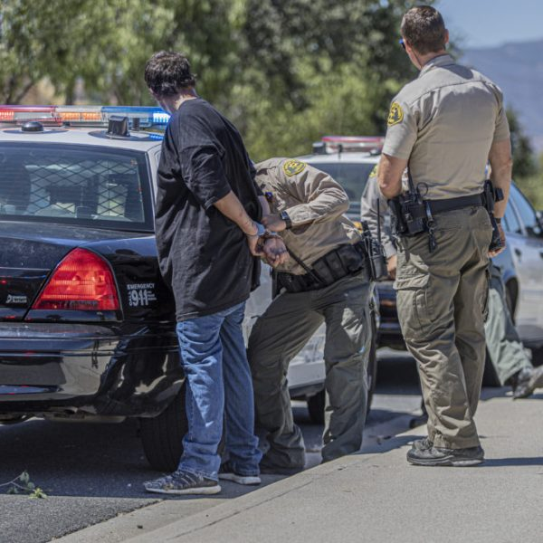Santa Clarita Valley Sheriff's Station deputies detain one person following reports of an attempted stabbing at a supermarket in Saugus late Monday morning. August 10, 2020. Bobby Block / The Signal.