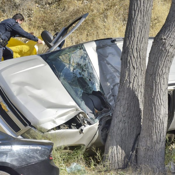 A California Highway Patrol Officer covers a body at the scene of  fatal crash involving a Chevrolet SUV on Bouquet Canyon Road in Texas Canyon on Saturday, August 16, 2020.  Dan Watson/The Signal