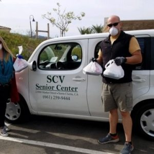 SCV Senior Center volunteers pose with meals they are delivering to seniors in the SCV through the center's home-delivered meals program. Courtesy