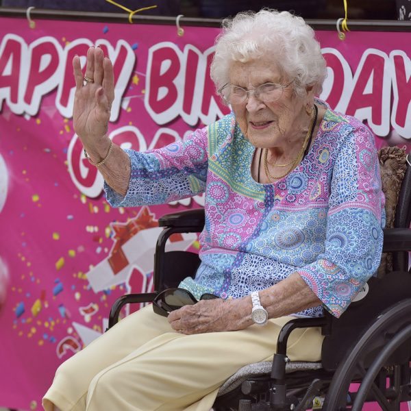 Milda Meacham waves to friends and family from her driveway as they drive by to celebrate her 101st Birthday in Santa Clarita on Friday, August 21, 2020.  Dan Watson/The Signal