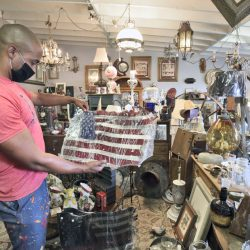 Customer Edwin Watt searches for items to decorate a bar at Rooster's Relics Antiques.  Dan Watson/The Signal