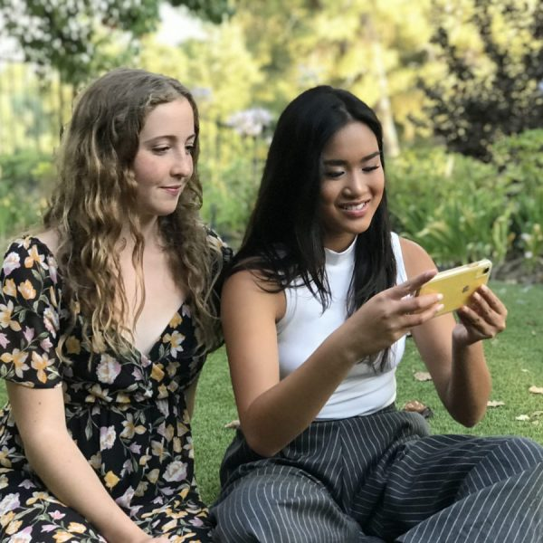 West Ranch High School seniors and tennis team co-captains Brooke Johnston and Shaira Busnawi, left to right, look at the Hiraeth blog they created on a cell phone. Courtesy
