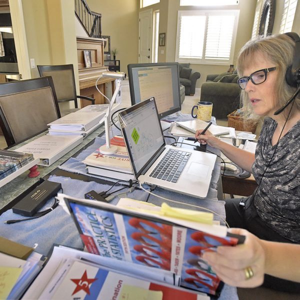 Golden Valley High School teacher Beth Flynn works from her dinning room table at her home in Valencia on Thursday, August 27, 20.  Dan Watson/The Signal