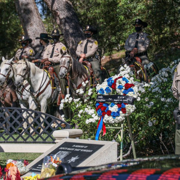 "Santa Clarita Valley Sheriff's Station deputies stand watch at a memorial for slain SCV Sheriff's Deputy Hagop ""Jake"" Kuredjian Monday morning. August 31, 2020. Bobby Block / The Signal."