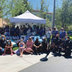 A group of LAPD officers and members of the community gathering outside the home of Val Martinez, 45, the LAPD officer who died in July due to complications with COVID-19. The gathering was organized in order to hold a baby shower for Megan Flynn, 34, Martinez's fiancee and fellow LAPD officer who is pregnant with their twin boys. Photo courtesy of the Flynn Family