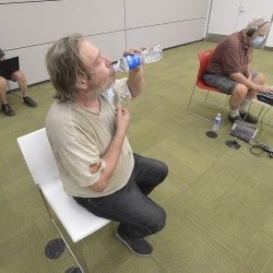 Chris Johnson, center, takes a drink of water as she joins Spencer Smith, left, and Harry Johnson in the cooling center at the Stevenson Ranch Library in Stevenson Ranch on Saturday, September 05, 2020. Dan Watson/The Signal