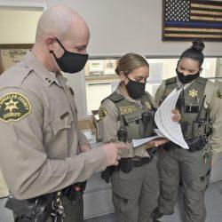 Capt. Justin Diez, left, speaks with deputies at the Santa Clarita Valley Sheriff's Station.  090820 Dan Watson/The Signal