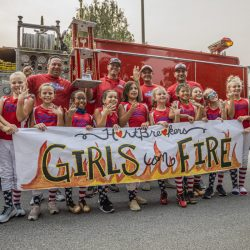 The members of the HARTbreakers softball team hold rings delivered by firefighters from Station 126 Sunday afternoon. September 13, 2020. Bobby Block / The Signal.