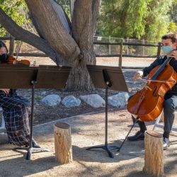Chloe Villamayor and Peter Walsh of the SCV Youth Orchestra perform