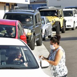 Dozens of cars line up to pick up their orders of tamales during the Our Lady of Perpetual Help's Talmale Drive Thru pick up at OLPH in Newhall on Friday, evening, September 18, 2020.  Dan Watson/The Signal